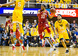 Feb 20, 2016; Morgantown, WV, USA; Oklahoma Sooners guard Jordan Woodard (10) attempts to pass during the first half against the West Virginia Mountaineers at the WVU Coliseum. Mandatory Credit: Ben Queen-USA TODAY Sports