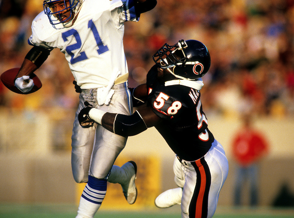 CHICAGO,IL-1987:  Chicago Bear linebacker Wilbur Marshall makes a hard tackle on Butch Woolfolk of the Detroit Lions during a game at Soldier Field, Chicago, Illinois during the fall of 1987.   (Photo by Ron Vesely)