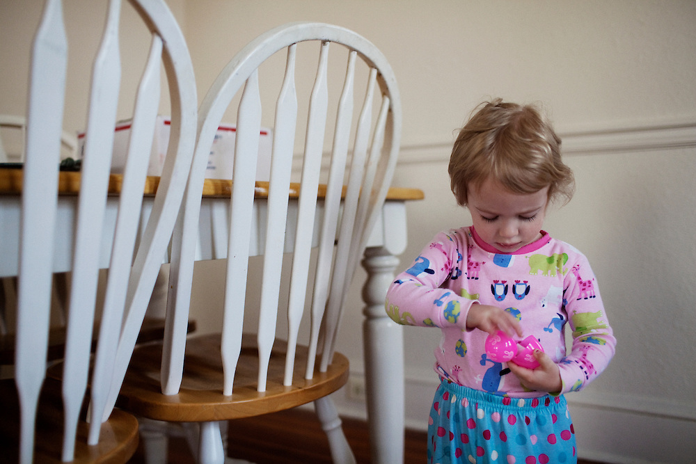 Madelyn Avery Eich, 2, inspects an Easter egg hidden by her mother on Easter Sunday, April 4, 2010 in her home in Norfolk, Virginia.