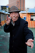 A pensioner spending his free time close to Haeundae beach. Busan, South Korea, Republic of Korea, KOR, 13th of February 2010.