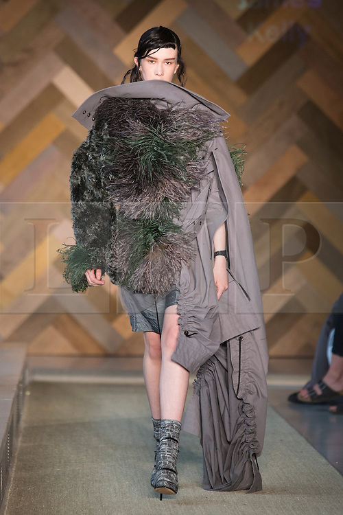 © Licensed to London News Pictures. 29/05/2014. London, England. Collection by James Kelly. 30 students of the Royal College of Art's prestigious MA Fashion programme presented their final collections in  a runway show at the RCA building in Kensington. Photo credit: Bettina Strenske/LNP