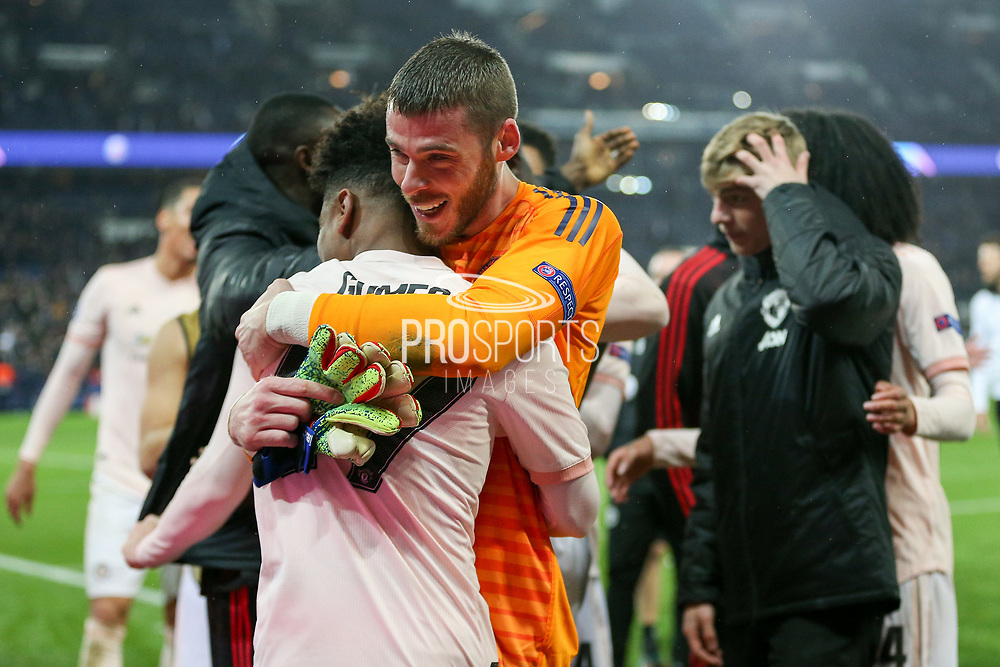 Manchester United Goalkeeper David De Gea celebrates with Manchester United Midfielder Angel Gomes during the Champions League Round of 16 2nd leg match between Paris Saint-Germain and Manchester United at Parc des Princes, Paris, France on 6 March 2019.