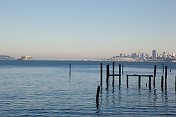 """Dock Pilings and San Francisco 1"" - This old dock pilings were photographed in Sausalito, San Francisco can be seen in the distance."