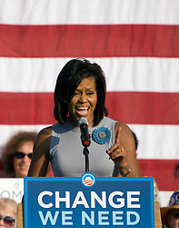 Michelle Obama speaks to supporters at a UVA rally.  Michelle Obama and Dr. Jill Biden appeared at a rally in the Newcomb Hall Plaza on the Grounds of the University of Virginia in Charlottesville, VA on September 17, 2008 to drum up support for their husband's Senator Barrack Obama (D-IL) and Senator Joe Biden (D-DE) and to raise awareness of women's issues.