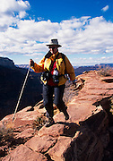 Diane Dammeyer explores Cedar Ridge, S. Kaibab Trail, Grand Canyon National Park, Arizona..Subject photograph(s) are copyright Edward McCain. All rights are reserved except those specifically granted by Edward McCain in writing prior to publication..McCain Photography.211 S 4th Avenue.Tucson, AZ 85701-2103.(520) 623-1998.mobile: (520) 990-0999.fax: (520) 623-1190.http://www.mccainphoto.com.edward@mccainphoto.com.