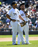CHICAGO - JUNE 23:  Jose Abreu #79 (L) and Yoan Moncada #10 of the Chicago White Sox look on during a pitching change against the Oakland Athletics on June 23, 2018 at Guaranteed Rate Field in Chicago, Illinois.  (Photo by Ron Vesely)  Subject: Jose Abreu; Yoan Moncada
