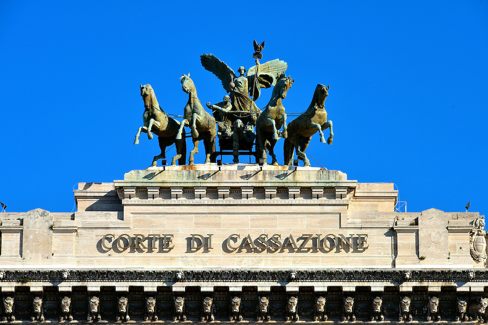 Quadriga Atop Palace of Justice in Rome, Italy<br /> Driving this four-horse chariot on top of the Palace of Justice is Victoria, the goddess of victory.  The bronze ensemble was created by Ettore Ximenes in 1926. During Roman antiquity, chariot races were extremely popular.  However, this winged deity was mostly associated with success during battle.  A temple in her honor was built nearby on Palatine Hill.