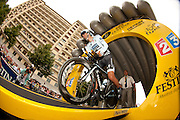 Alberto Contador leaves the start gate at the pen-ultimate stage (Grenoble-Grenoble time-trial) of the 2011 Tour de France. Image by Greg Beadle