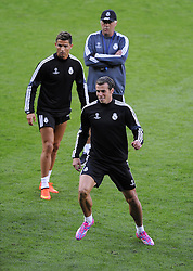 Real Madrid's Cristiano Ronaldo and Real Madrid's Gareth Bale train in front of Real Madrid Manager, Carlo Ancelotti - Photo mandatory by-line: Joe Meredith/JMP - Mobile: 07966 386802 11/08/2014 - SPORT - FOOTBALL - Cardiff - Cardiff City Stadium - Real Madrid v Sevilla - UEFA Super Cup - Press Conference and Open Training session
