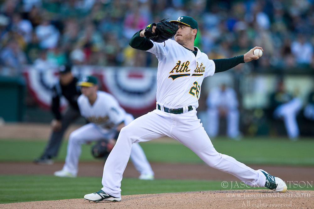 OAKLAND, CA - JULY 05:  Scott Kazmir #26 of the Oakland Athletics pitches against the Toronto Blue Jays during the first inning at O.co Coliseum on July 5, 2014 in Oakland, California. The Oakland Athletics defeated the Toronto Blue Jays 5-1.  (Photo by Jason O. Watson/Getty Images) *** Local Caption *** Scott Kazmir