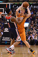 Apr 1, 2016; Phoenix, AZ, USA; Phoenix Suns forward Chase Budinger (10) handles the ball in front of Washington Wizards guard Bradley Beal (3) during the second half at Talking Stick Resort Arena. The Washington Wizards won 106- 99. Mandatory Credit: Jennifer Stewart-USA TODAY Sports
