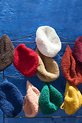 CHEFCHAOUEN, MOROCCO - 27th APRIL 2016 -  Colourful beanie hats for sale in the souks of the Chefchaouen Medina - the blue city - Rif Mountains, Northern Morocco.