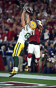 Arizona Cardinals cornerback Patrick Peterson (21) leaps from behind while trying to break up a 41 yard Hail Mary pass caught by Green Bay Packers wide receiver Jeff Janis (83) for a touchdown that ties the score at 20-20 with no time left on the game clock, sending the game into overtime during the NFL NFC Divisional round playoff football game against the Green Bay Packers on Saturday, Jan. 16, 2016 in Glendale, Ariz. The Cardinals won the game in overtime 26-20. (©Paul Anthony Spinelli)
