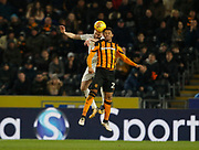 Fraizer Campbell of Hull City and Gaetano Berardi of Leeds United contest an aerial ball during the EFL Sky Bet Championship match between Hull City and Leeds United at the KCOM Stadium, Kingston upon Hull, England on 30 January 2018. Photo by Paul Thompson.