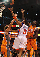 Mar. 26 2010; Phoenix, AZ, USA; New York Knicks guard Tracy McGrady (3) puts up a shot against Phoenix Suns center Robin Lopez (15) and forward Amare Stoudemire (1) in the first half at the US Airways Center.  Mandatory Credit: Jennifer Stewart-US PRESSWIRE.