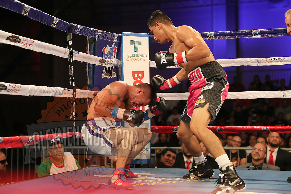 Jonathan Lecona gets knocked out by Melvin Lopez during a Telemundo boxing match at Osceola Heritage Park on Friday, July 20, 2018 in Kissimmee, Florida.  (Alex Menendez via AP)