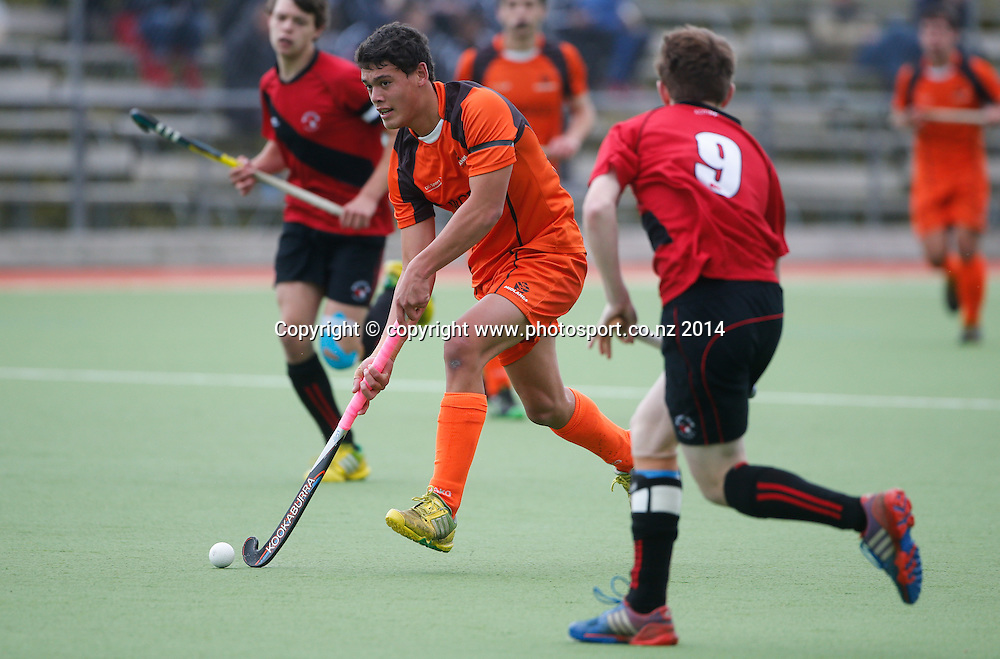 Midland's Te Hiraka Chase looks for a way through the defence. Canterbury v Midlands, Final - National U18 Regional Hockey Tournament, Napier, New Zealand. Saturday, 12 July, 2014. Photo: John Cowpland / photosport.co.nz