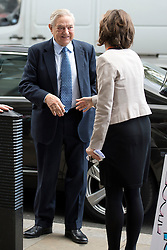© London News Pictures. 29/10/2013 . London, UK. Chairman of Soros Fund Management, George Soros (left), arriving at Portcullis House in Westminster, central London. Photo credit : Ben Cawthra/LNP