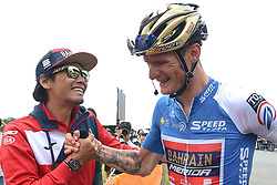 May 26, 2018 - Izu, Japan - Slovenian rider Grega Bole from Bahrain - Merida Team celebrates his win with his team-mate Yukija Arashiro, just after winning Izu stage, the seventh stage of Tour of Japan 2018. Spanish rider Marcos Fernandez Garcia from Kinan Cycling Team keeps the race Leader Green Jersey..On Saturday, May 26, 2018, in Izu, Shizuoka Prefecture, Japan. (Credit Image: © Artur Widak/NurPhoto via ZUMA Press)