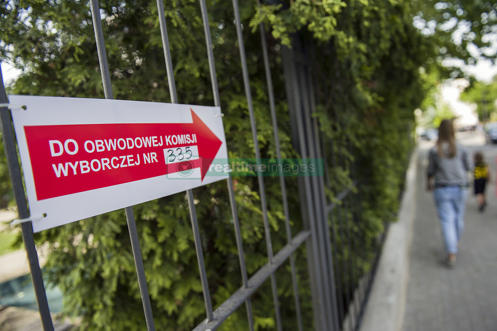 May 26, 2019 - Warsaw, Mazowieckie, Poland - A poster seen hanging on a school fence showing the direction to the entrance of the polling station during the EU elections..European Parliament elections in Warsaw, Poland. (Credit Image: © Attila Husejnow/SOPA Images via ZUMA Wire)