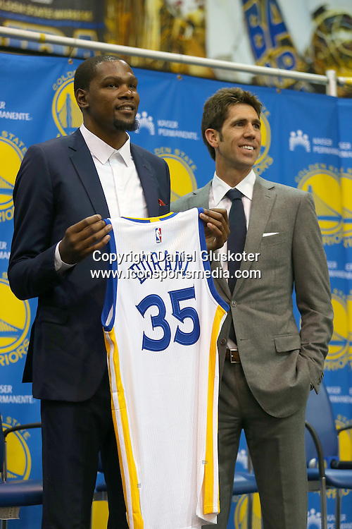 July 07, 2016 Oakland, CA: New Golden State Warriors forward Kevin Durant is introduced after signing a two-year, $54.3 million contract during a press conference at the teams practice facility in Oakland, CA. (Photograph by Daniel Gluskoter/Icon Sportswire)
