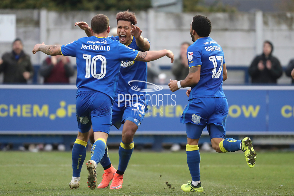AFC Wimbledon striker Lyle Taylor (33) celebrating after scoring goal with AFC Wimbledon striker Cody McDonald (10) during the The FA Cup match between AFC Wimbledon and Charlton Athletic at the Cherry Red Records Stadium, Kingston, England on 3 December 2017. Photo by Matthew Redman.