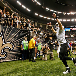 Sep 21, 2014; New Orleans, LA, USA; New Orleans Saints quarterback Drew Brees (9) celebrates after a win against the Minnesota Vikings in a game at Mercedes-Benz Superdome. The Saints defeated the Vikings 20-9. Mandatory Credit: Derick E. Hingle-USA TODAY Sports