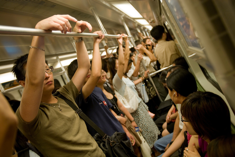 Asia, China, Shanghai, Passengers crowded onto Metro underground subway train near People's Square during morning rush hour.