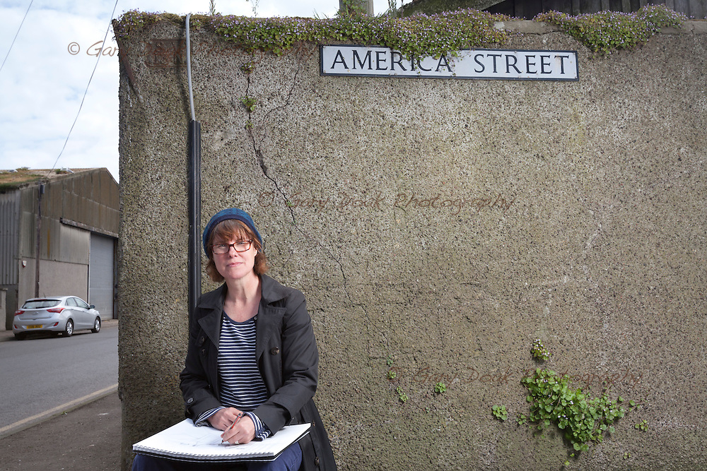 Artist, Dominique Cameron drawing in America Street, Montrose, on part of her walk through the town that informs her body of work being exhibited at the Wall Projects gallery.<br /> The exhibition comprises mixed media painting and drawing, text and a short film and opens on 4th June.<br /> Wall projects is based in the old rope works in Bent's Road, Montrose.<br /> <br /> May 2016<br /> Picture by Gary Doak.