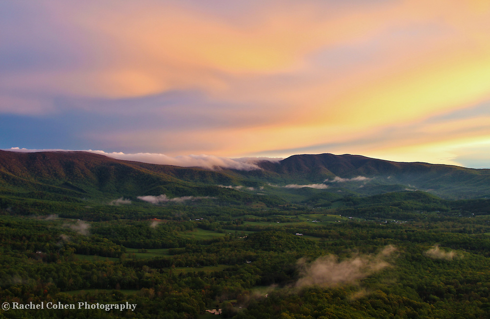 &quot;Sunset in the Valley&quot;<br /> <br /> Beautiful low clouds pass through and on the mountains as pastel hued skies make the transition from day to sunset!!<br /> <br /> The Blue Ridge Mountains by Rachel Cohen