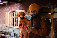 Manohar Nath, a sadhu born in Milan, with an Italian sadhu on the left who is a chela of Yogi Krishnanath at Kalimandir.<br />