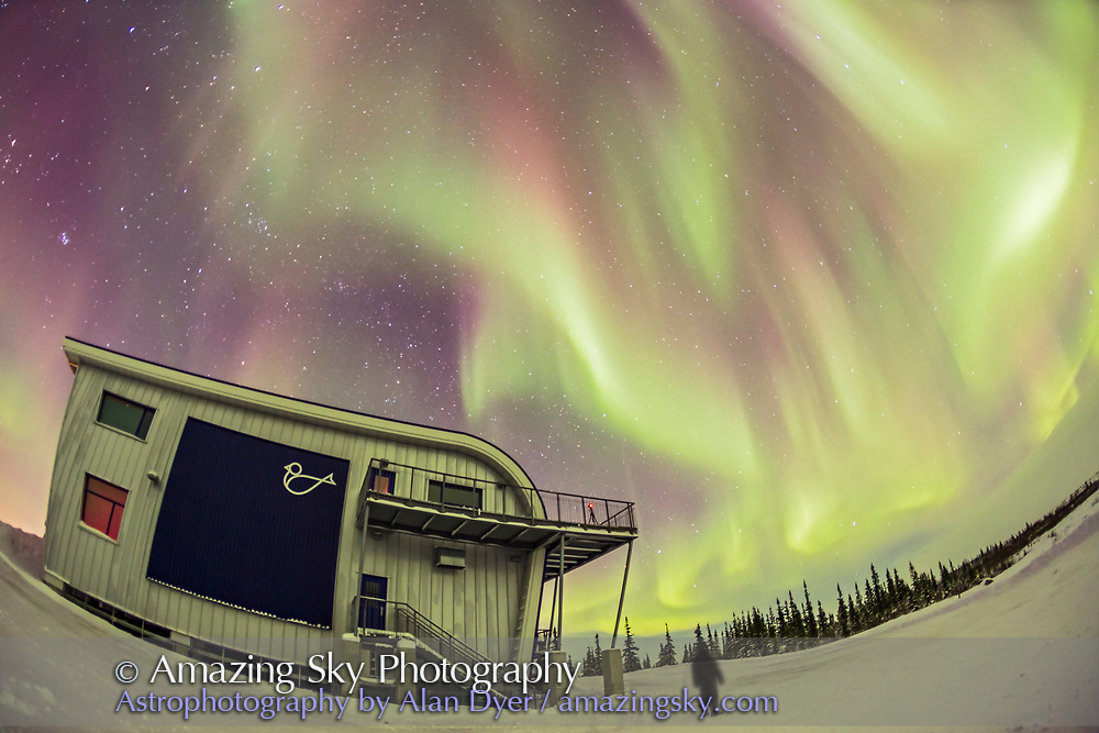 A lone figure gazes skyward at the aurora over the Churchill Northern Studies Centre, Churchill, Manitoba. I shot this Feb 4, 2016 on a night with temperatures of -35° C with a slight wind. Exposure was 13 seconds at f/2.8 with the 15mm lens anf Canon 6D at ISO 3200.
