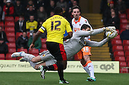 Picture by David Horn/Focus Images Ltd +44 7545 970036.09/03/2013.Jonathan Bond (GK) of Watford (centre) saves a loose ball while Lloyd Doyley of Watford (left) and Matt Derbyshire of Blackpool look on during the npower Championship match at Vicarage Road, Watford.