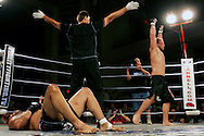Referee waves the fight over after Al Martinez gets knocked out in the 3rd round, in the background Brian Kononchik raises his arms in victory.  Al Martinez was a boxer before contemplating a shot a Ultimate fighting, this was Al's first and last fight after losing it.  Ultimate fighting is a mixed martial arts type of fighting where almost any type of strike is possible.  Anything from punches to kicks to knee thrusts are legal, creating a type of extreme fighting in the ring.  The popularity of ultimate fighting in the United States has skyrocketed since the mainstream media has given it greater coverage.