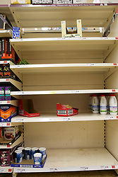 © Licensed to London News Pictures. 05/03/2020. London, UK. Empty shelves in a Sainsbury's store in London amid an increased number of cases of Coronavirus (COVID-19) in the UK. Three more cases were confirmed in Scotland this morning, taking the UK total to ninety. Photo credit: Dinendra Haria/LNP