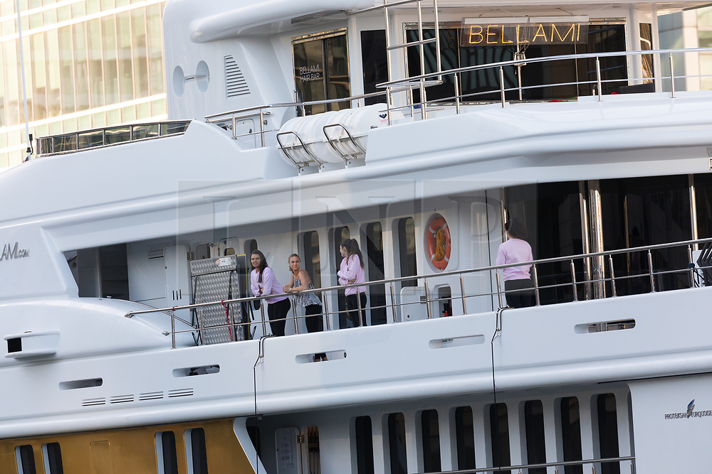 © Licensed to London News Pictures. 17/09/2019. London, UK. Crew on board look out as gold wrapped, 175 feet long superyacht, Bellami.com arrives in East India Dock. It took 13 days and 600sqm of gold chrome vinyl wrap to cover the superyacht formally known as 'Kinta' at the Port of Viareggio in Italy this year and is the largest chrome yacht wrap done fully in the water and possibly the largest chrome wrap ever. As Bellami.com arrived, it was noticed that some of the chrome wrap was already damaged and missing. Photo credit: Vickie Flores/LNP