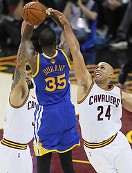 The Cleveland Cavaliers' Richard Jefferson (24) and Deron Williams conspire to block a shot by the Golden State Warriors' Kevin Durant (35) in the third quarter during Game 4 of the NBA Finals at Quicken Loans Arena in Cleveland on Friday, June 9, 2017. The Cavs won, 137-116, trimming their series deficit to 3-1. (Photo by Leah Klafczynski/Akron Beacon Journal/TNS) *** Please Use Credit from Credit Field ***