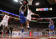 January 14, 2012 -  DePaul Blue Demons guard Brandon Young (20) takes a short jumper with Louisville Cardinals guard Peyton Siva (3) defending during an NCAA basketball game between DePaul and (#15) Louisville. at the KFC Yum! Center in Louisville, Kentucky. Louisville beat DePaul 76-59.