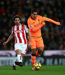 Stoke City's Joe Allen (left) and Liverpool's Roberto Firmino battle for the ball