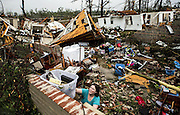April 28, 2014 - Tupelo, Mississippi, U.S. - <br /> <br /> Deadly Tornadoes Devastate Central and Southern US States<br /> <br /> JODI WALLS pushes a box of belongings out of a friend's house while cleaning up after a large tornado made its way along Clayton Ave. <br /> ©Exclusivepix