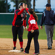 02 March 2018: San Diego State softball hosts Minnesota on day two of the San Diego Classic I at Aztec Softball Stadium. San Diego State third baseman Molly Sturdivant (31) is congratulated by coachMia Longfellow after driving in a run in the bottom of the fourth. The Aztecs beat the #21/20 Gophers 6-2.<br /> More game action at sdsuaztecphotos.com