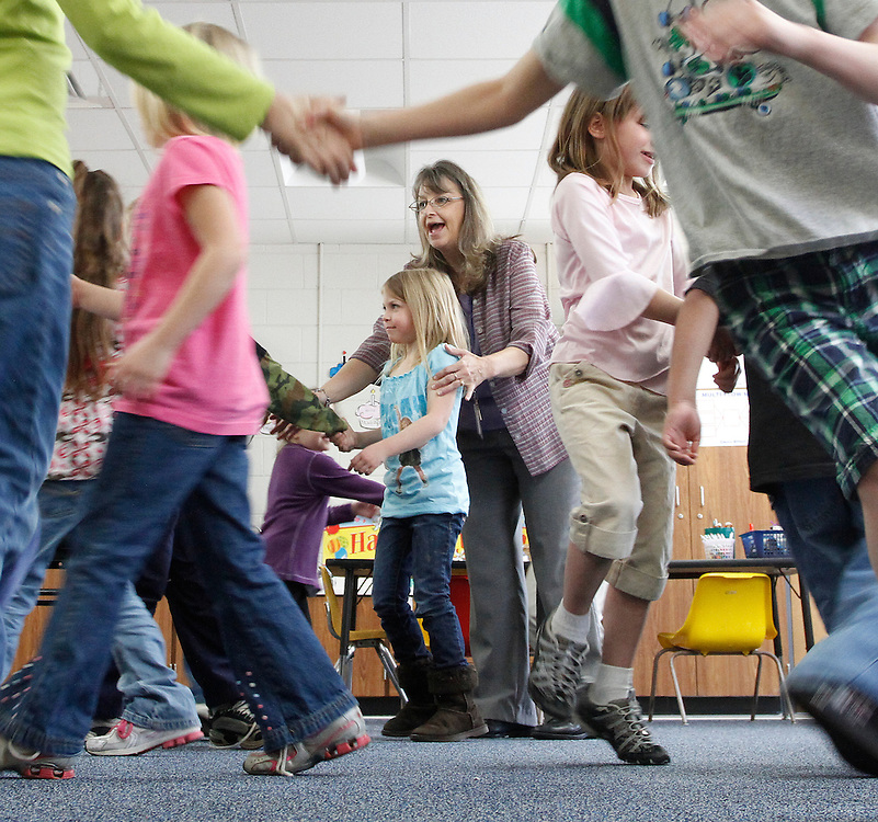 Auburn Elementary School teacher Peggy Barnes leads her class in a dance on Tuesday, March 9, 2010.  The students learned various dance related vocabulary words in the exercise.