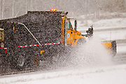A snow plow drives on interstate 43 in Green Bay, Wisconsin druing a snow strom in March 2011.(Photo by Mike Roemer)