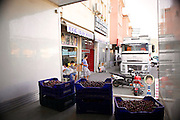 Cherries being loaded on to the back of the delivery van ready to deliver to tourist hotels.