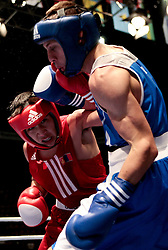 Milan, 09-09-2009 ITALY - Aiba World Boxing Championship Milan 2009. Fly 51 kg quarter finals..Pictured: Nyambayar Tugstsogt MGL red vs Picardi Vincenzo blue.Photo by Giovanni Marino/OTNPhotos . Obligatory Credit