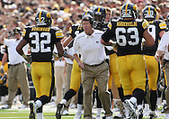 September 19, 2009: Iowa offensive coordinator Ken O'Keefe greets Iowa running back Adam Robinson (32) after his 2 yard touchdown run during the Iowa Hawkeyes' 27-17 win over the Arizona Wildcats at Kinnick Stadium in Iowa City, Iowa on September 19, 2009.