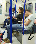 Sadia Khan at London's Night Tube launch at Brixton tube station, London, Great Britain <br /> 19th August 2016 <br /> <br /> a passenger fast asleep <br /> <br /> Sadia Khan, mayor of London,  launched the first night tube service and travelled on a tube train between Brixton and Walthamstow on the Victoria Line. <br />  <br /> He launched the first 24 hour Friday and Saturday night services on the Central and Victoria lines <br /> <br /> Photograph by Elliott Franks <br /> Image licensed to Elliott Franks Photography Services