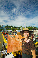 The annual arts walk held in Cowichan Bay attracts artisans from all over Vancouver Island, painting and displaying their original works of art.  Cowichan Bay, Vancouver Island, British Columbia, Canada.