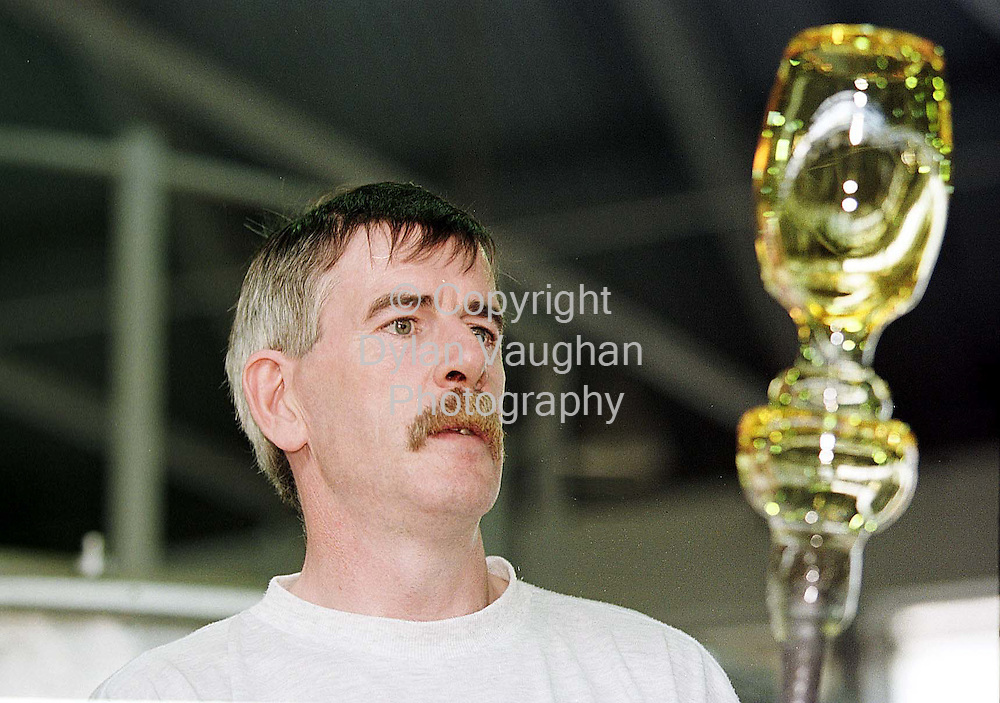 11/8/98 .file picture.MASTER BLOWER SEAN FLYNN PICTURED EXAMINING HIS WORK IN THE WATERFORD CRYSTAL PLANT IN WATERFORD.PICTURE DYLAN VAUGHAN