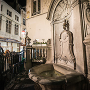The Mannekin Pis, a small bronze fountain sculpture of a naked little boy urinating into the fountain. Installed in about 1619 by Hiëronymus Duquesnoy the Elder, it is a cultural symbol of the city of Brussels and a famous tourism landmark.
